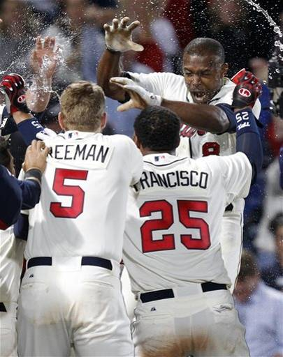 Justin Upton is doused by teammates after his walk-off home run. (AP Photo/Butch Dill)