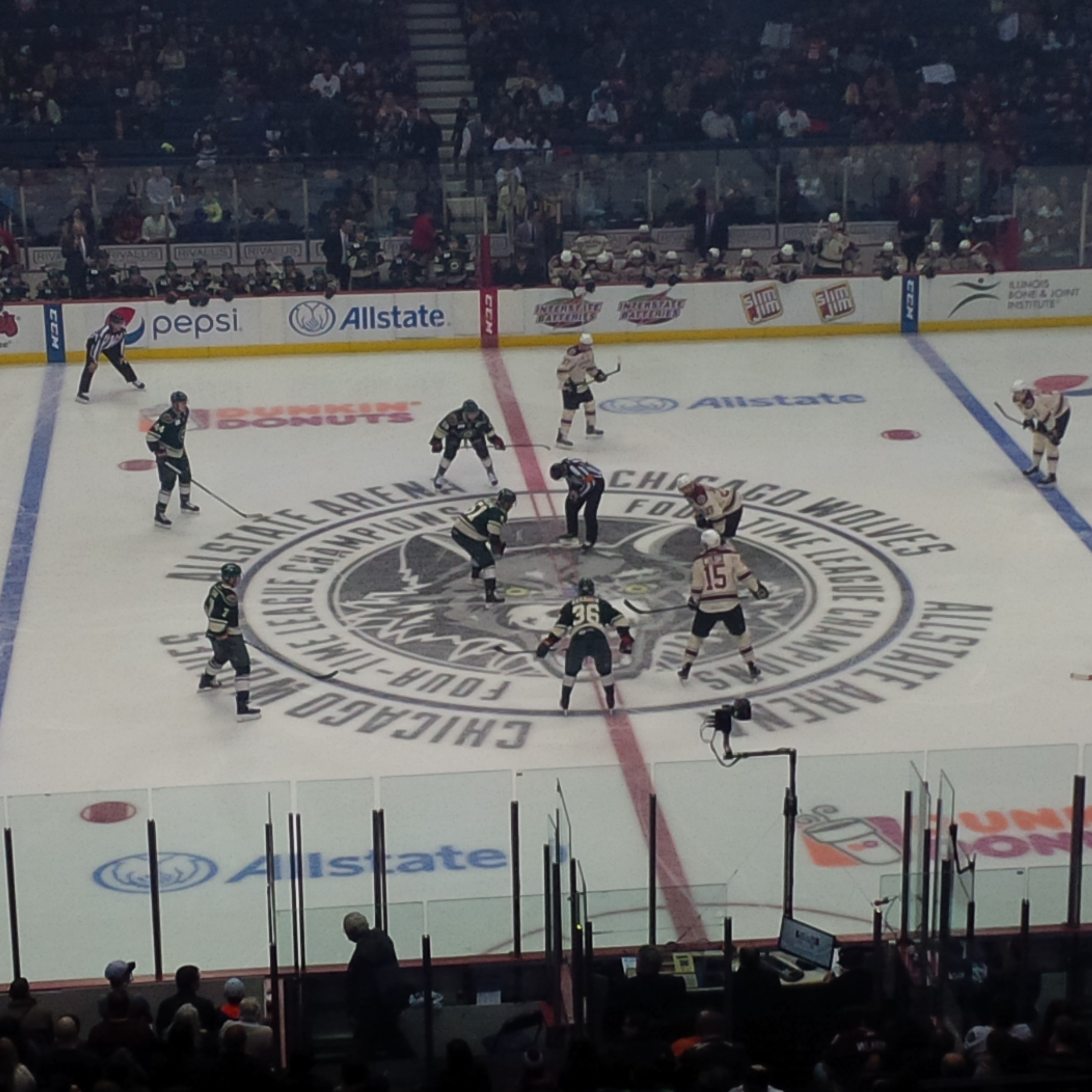 The Wolves (white jerseys) opening face-off against Iowa.