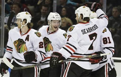 Blackhawks' Brandon Saad, second from left, celebrates his first career goal with teammates (AP Photo).