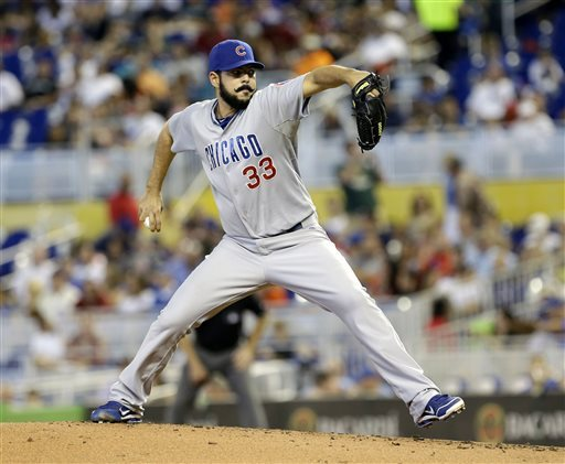 The Associated Press 2013-04-28   Chicago Cubs' Carlos Villanueva pitches to the Miami Marlins in the first inning of a baseball game in Miami, Sunday, April 28, 2013. (AP Photo/Alan Diaz)