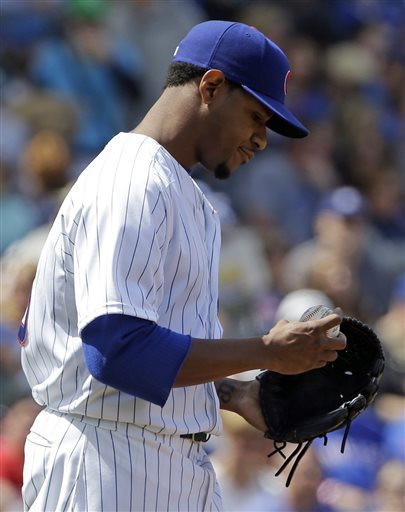 Chicago Cubs starter Edwin Jackson reacts after Cincinnati Reds' Jay Bruce hit an one-run double during the fourth inning of a baseball game in Chicago, Sunday, May 5, 2013. (AP Photo/Nam Y. Huh)