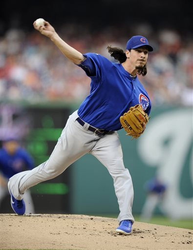 Chicago Cubs starter Jeff Samardzija throws to a Washington Nationals batter during the first inning of a baseball game, Friday, May 10, 2013, in Washington. (AP Photo/Nick Wass)