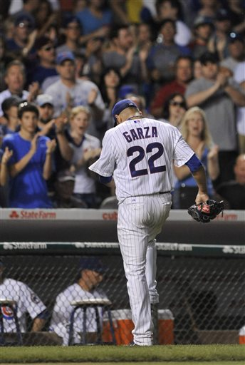 Chicago Cubs starting pitcher Matt Garza walks off the field after being pulled during the seventh inning of a baseball game against the St. Louis Cardinals in Chicago, Saturday, July 13, 2013. Chicago won 6-4. (AP Photo/Paul Beaty)