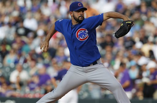 Chicago Cubs starting pitcher Carlos Villanueva works against the Colorado Rockies in the first inning of a baseball game in Denver on Saturday, July 20, 2013, in Denver. (AP Photo/David Zalubowski)