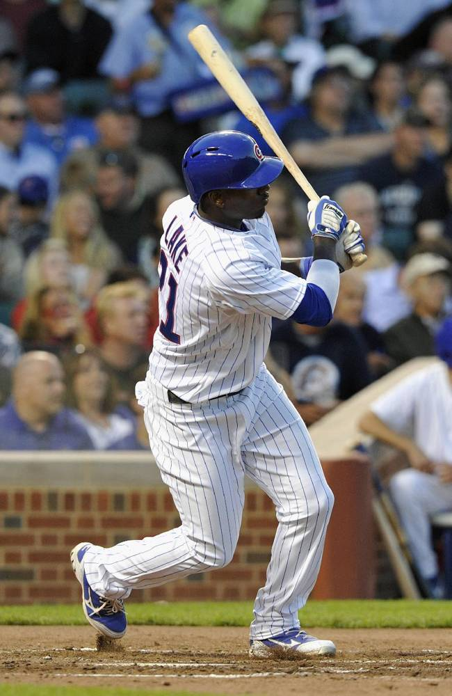 Chicago Cubs' Junior Lake singles against the Milwaukee Brewers during the fourth inning of a baseball game, Monday, July 29, 2013, in Chicago. (AP Photo/Jim Prisching)