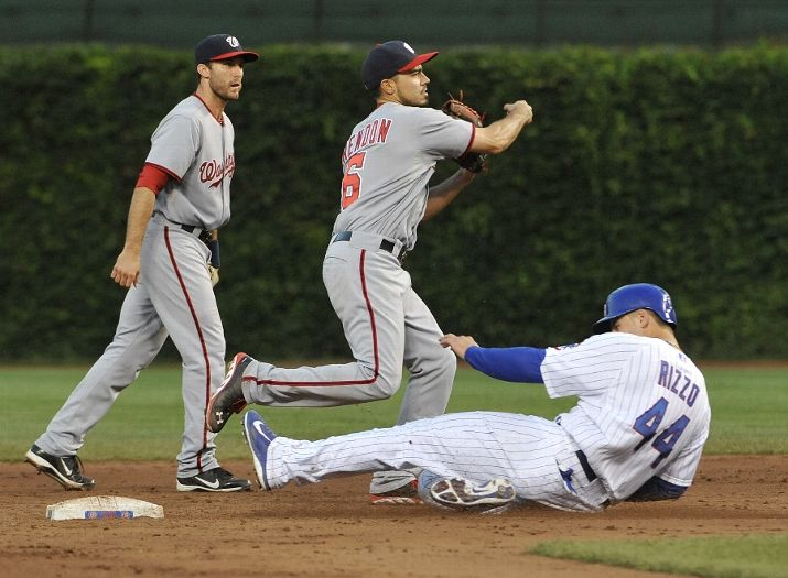SS Anthony Rendon turns the game ending double play to win in 13. (David Banks / Getty Images)