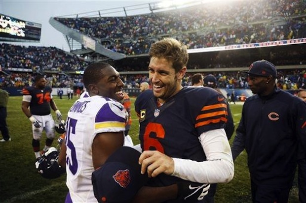 Jay Cutler smiles with Minnesota's Greg Jennings after an up-and-down afternoon.  (AP Photo/Charles Rex Arbogast)