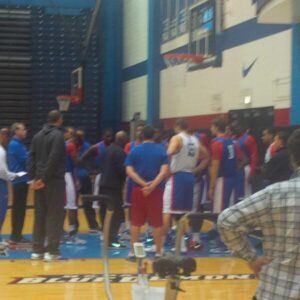 DePaul head coach Oliver Purnell huddles his team before practice.