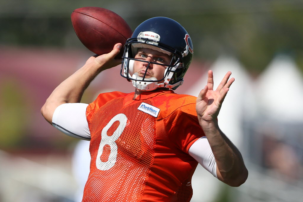 Bears quarterback Jimmy Clausen throws during training camp (photo taken by the Chicago Tribune).