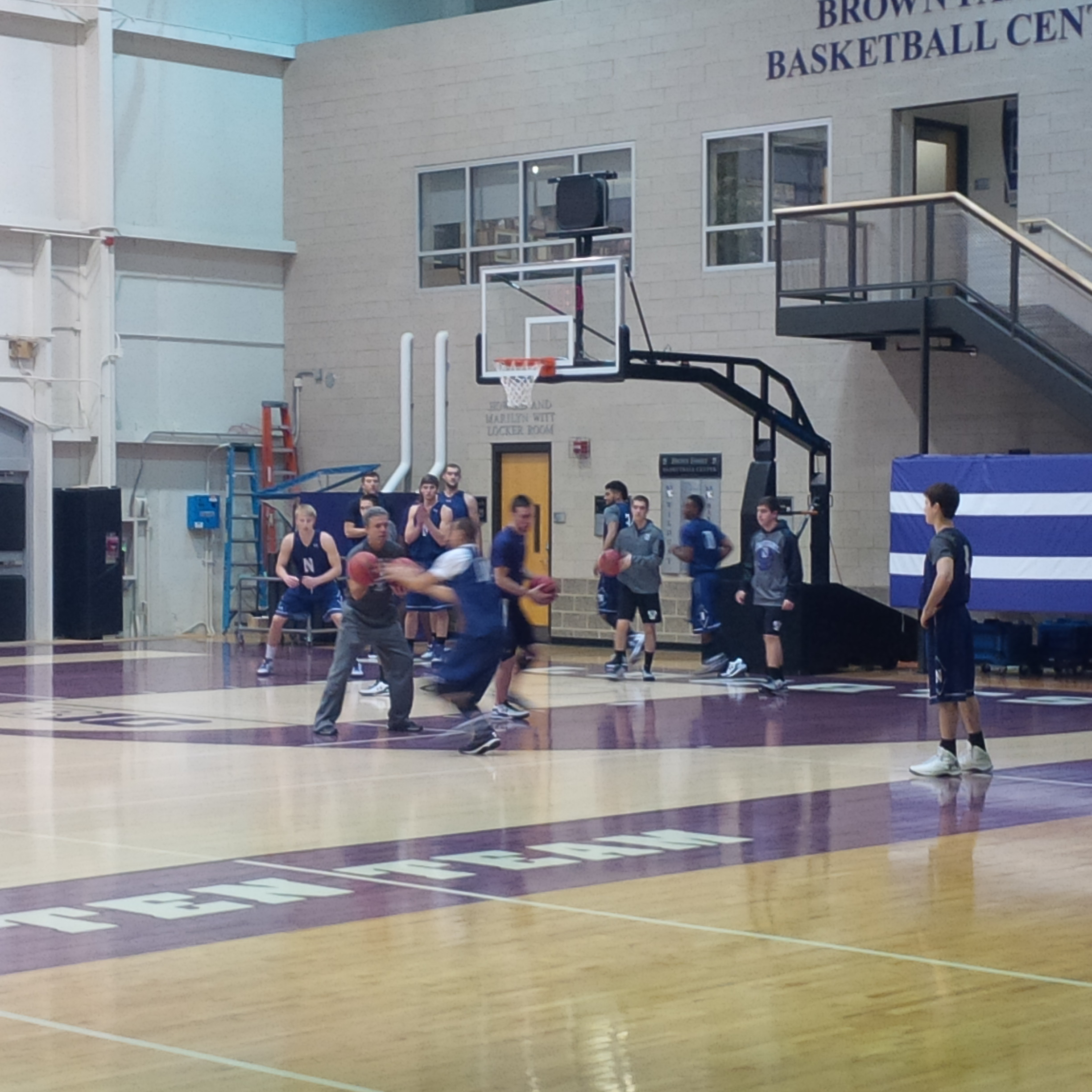 The Northwestern Wildcats basketball team warms up before Wednesday's practice.