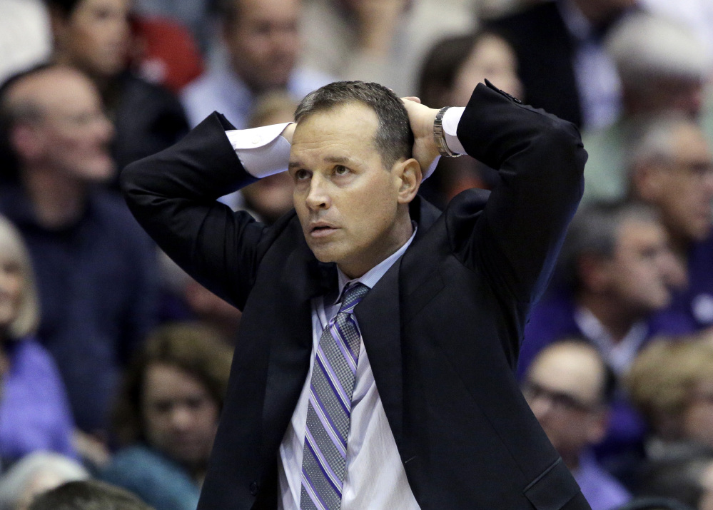 A visibly frustrated Chris Collins roams the sidelines at Welsh-Ryan Arena on Thursday night (photo from the Chicago Sun-Times).
