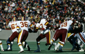 Washington Redskins quarterback Doug Williams (17) prepares to handoff to running back Timmy Smith (36) during the Redskins 21-17 victory over the Chicago Bears in the 1987 NFC Divisional Playoff Game on January 10, 1988 at Soldier Field in Chicago, Illin 1987 NFC Divisional Playoff Game - Washington Redskins vs Chicago Bears - January 10, 1988 (AP Photo/NFL Photos)