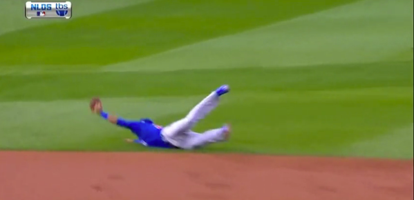 Chicago Cubs shortstop Addison Russell makes a great play.
